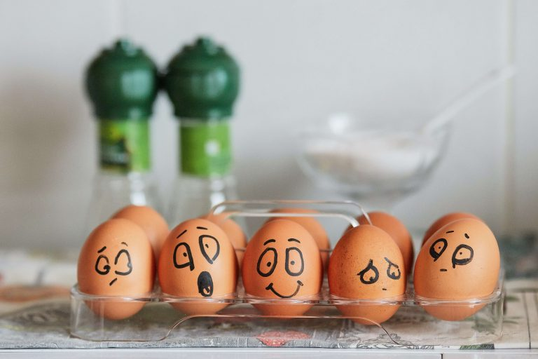 eggs with different facial expressions painted on them