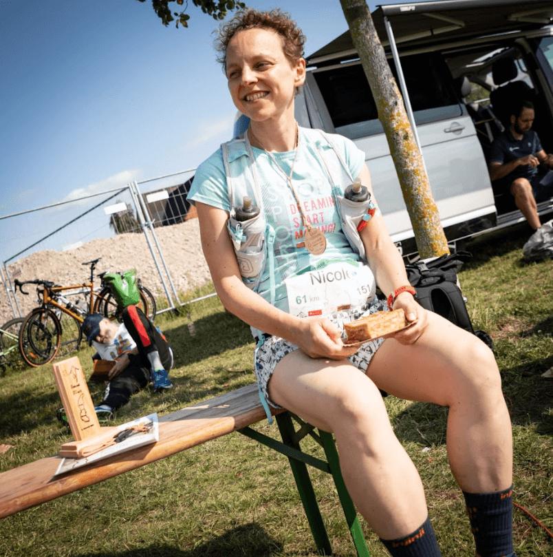 Nicole Linke sitting on a bench after Schwerin Ultramarathon